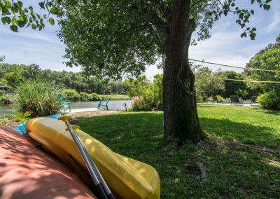 Backyard View of Kayaks and Volleyball Net